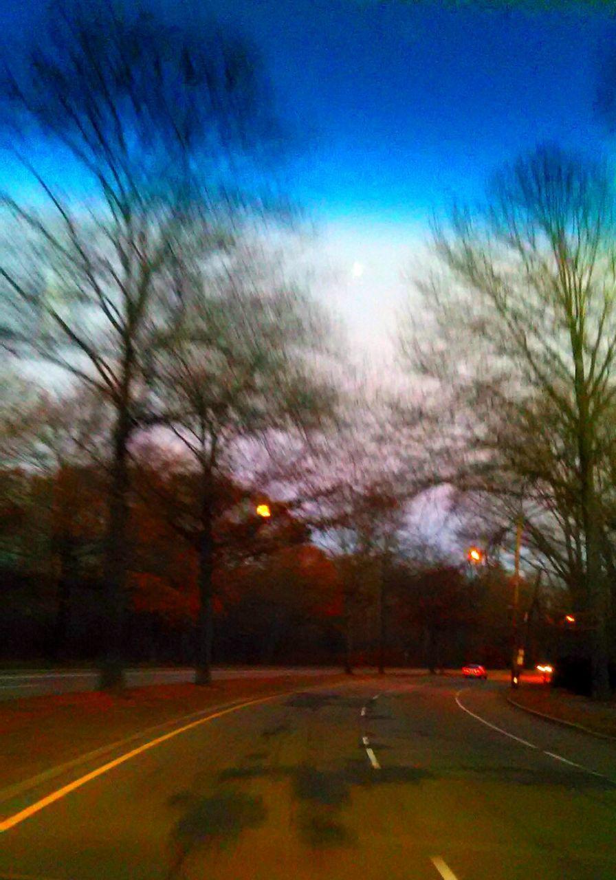 road, transportation, car, street, tree, the way forward, outdoors, land vehicle, no people, illuminated, day, sky, nature