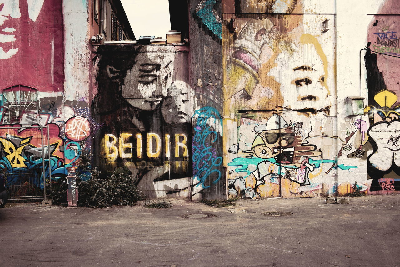 Bei Dir Abandoned Adapted To The City Architecture Built Structure City Communication Creativity Day Graffiti Mother And Child Mother Love Motherhood Moments No People Outdoors Spray Paint Street Art Text