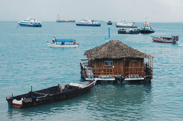 Sea Transportation Floating House Floating Floating On Water Floating Restaurant Blue Vacations Travel Destinations Beauty In Nature Cloud - Sky Horizon Over Water Clear Sky Zanzibar_Tanzania Zanzibarisland Zanzibar Nature Sky Beach Water Day Mode Of Transport Transportation Sand house