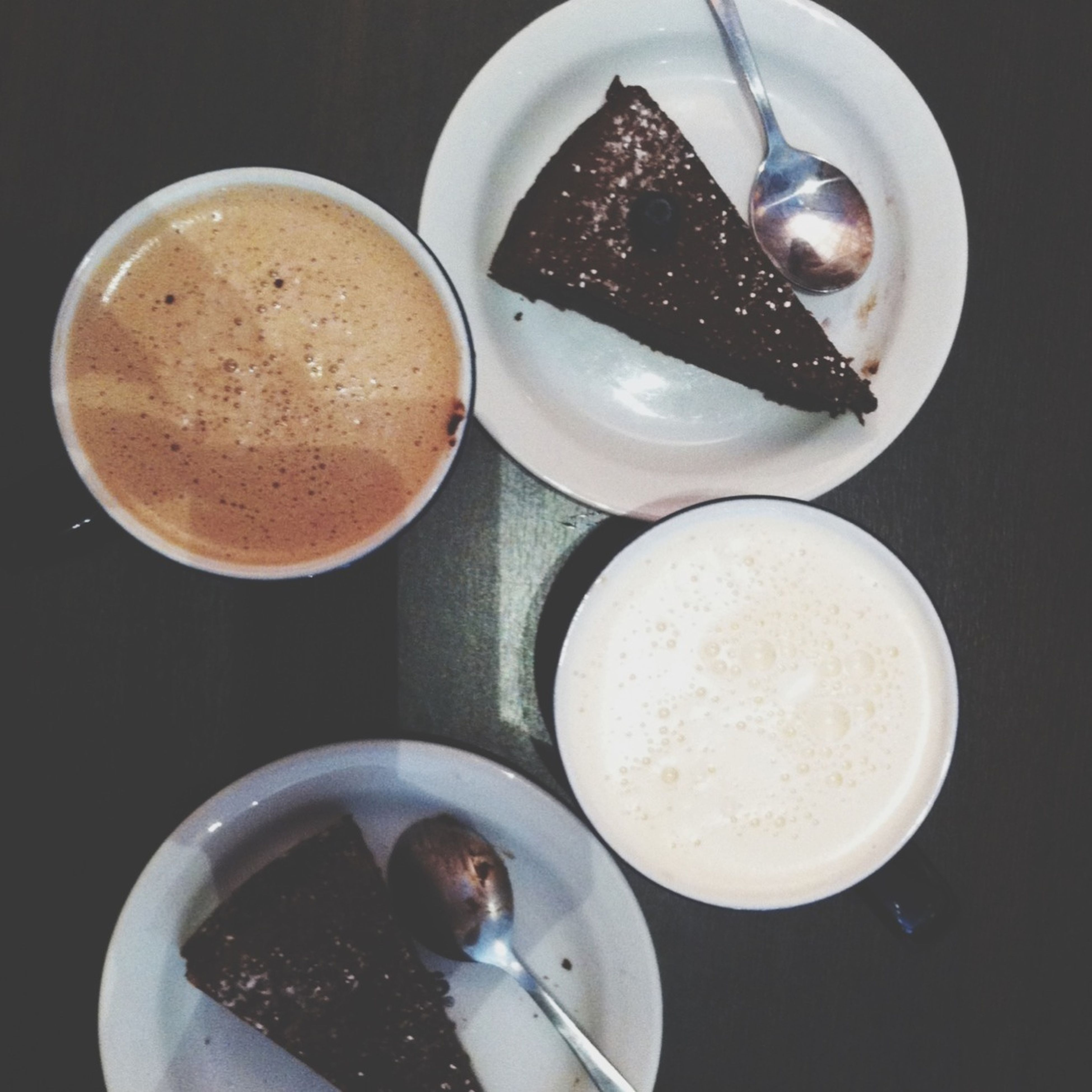 food and drink, indoors, food, freshness, still life, table, high angle view, plate, drink, healthy eating, spoon, ready-to-eat, coffee cup, coffee - drink, refreshment, breakfast, sweet food, bowl, fork, close-up