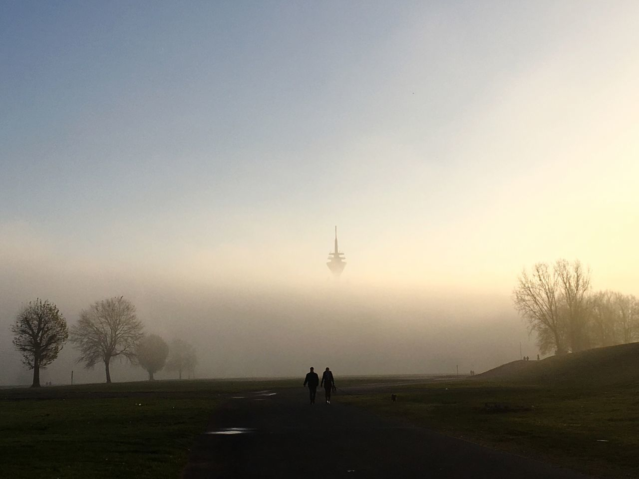 fog, foggy, tree, nature, field, mist, weather, grass, real people, sky, bare tree, two people, hazy, landscape, outdoors, men, beauty in nature, silhouette, togetherness, scenics, sunset, full length, water, day, friendship, people