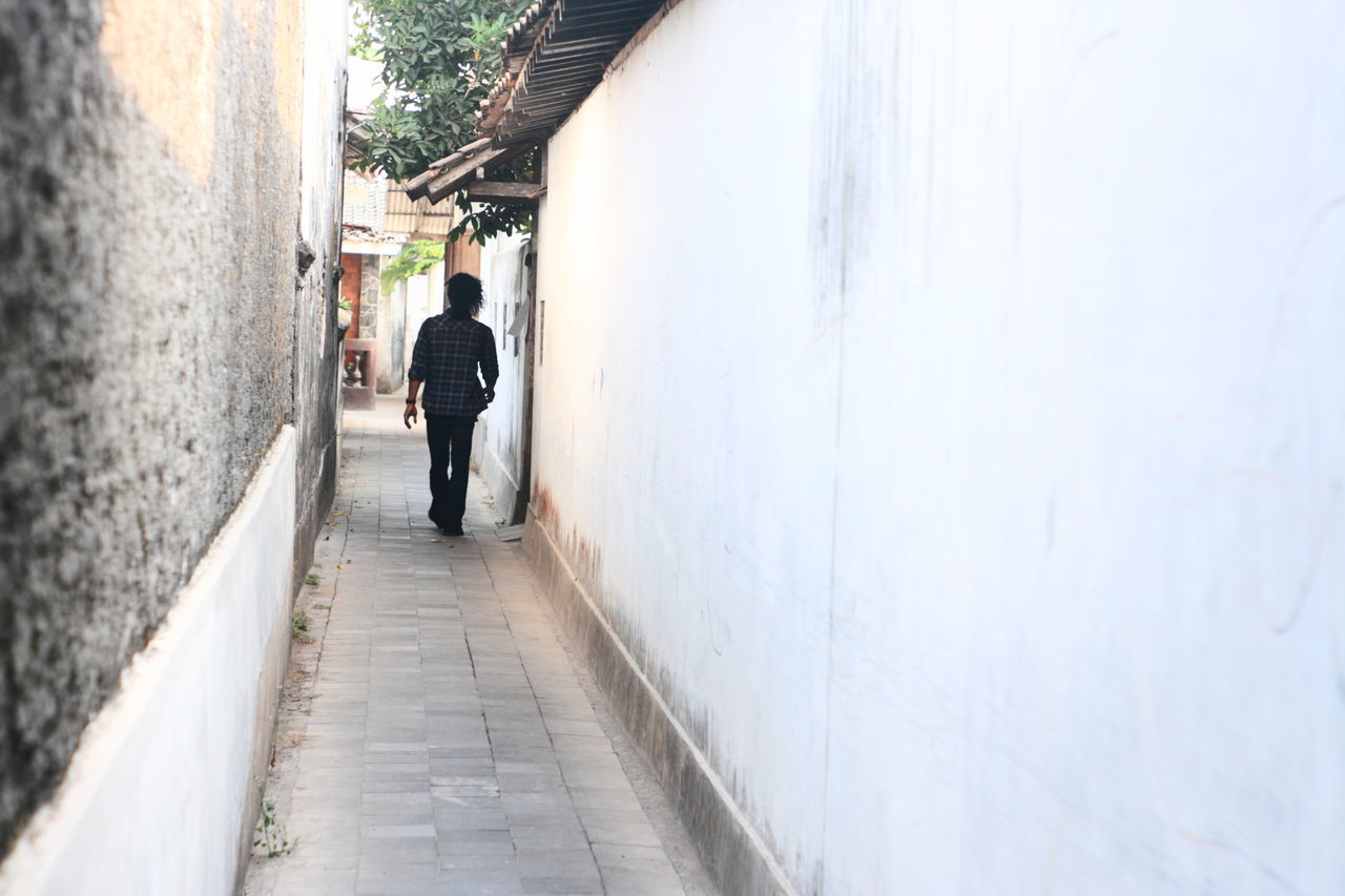 pathway in kota gede Adult Architecture Building Exterior Built Structure City Day Full Length Gang Lifestyles Men One Man Only One Person Only Men Outdoors Pathway People Real People Standing The Way Forward Walking