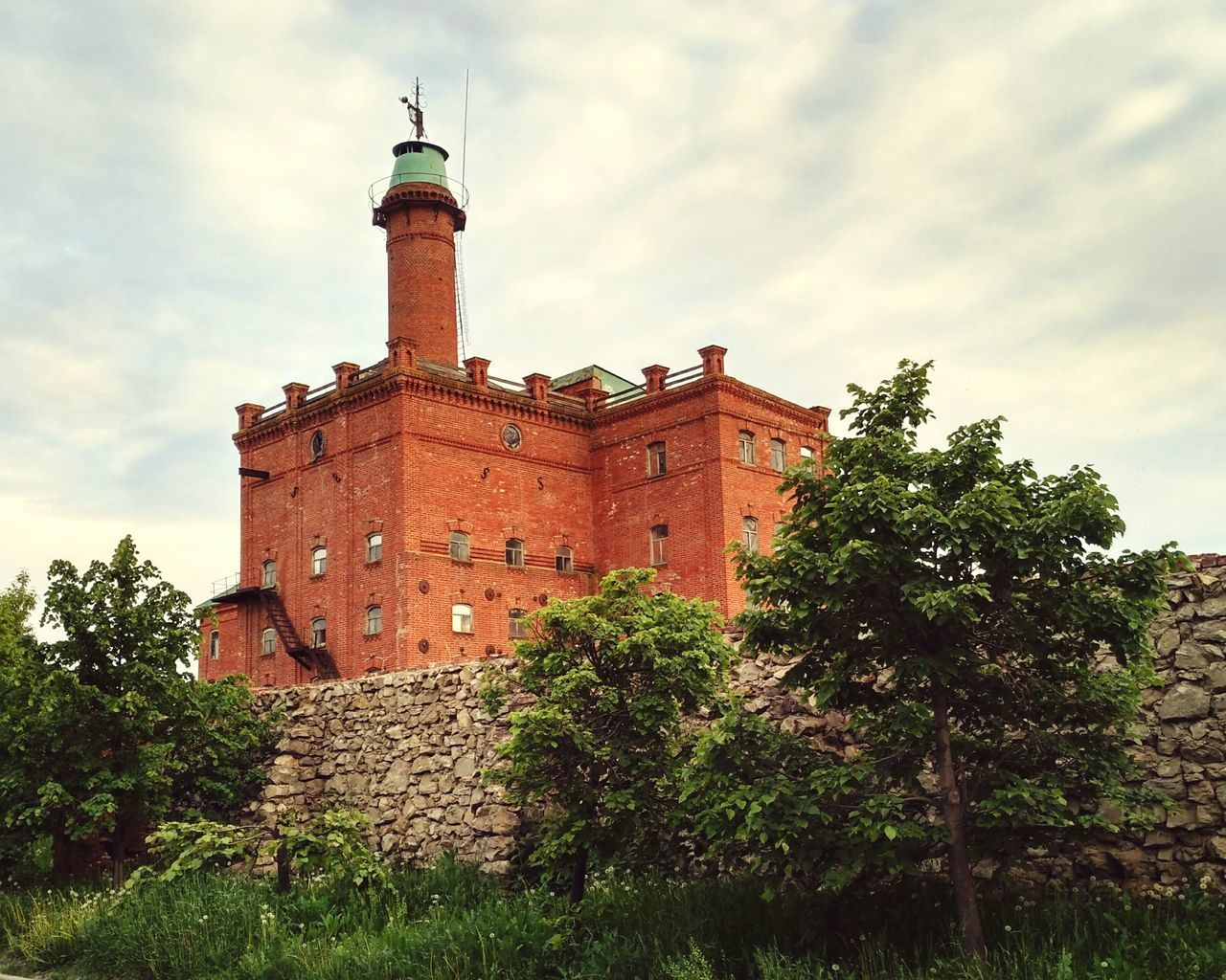 Architecture Building Exterior Low Angle View Cloud - Sky Sky Tree Outdoors Built Structure No People Day Architecture City Mobile Photography Building Russia Ruins Abandoned Buildings Red 1907 Vintage Retro Russian Imperia Red Nature The Architect - 2017 EyeEm Awards
