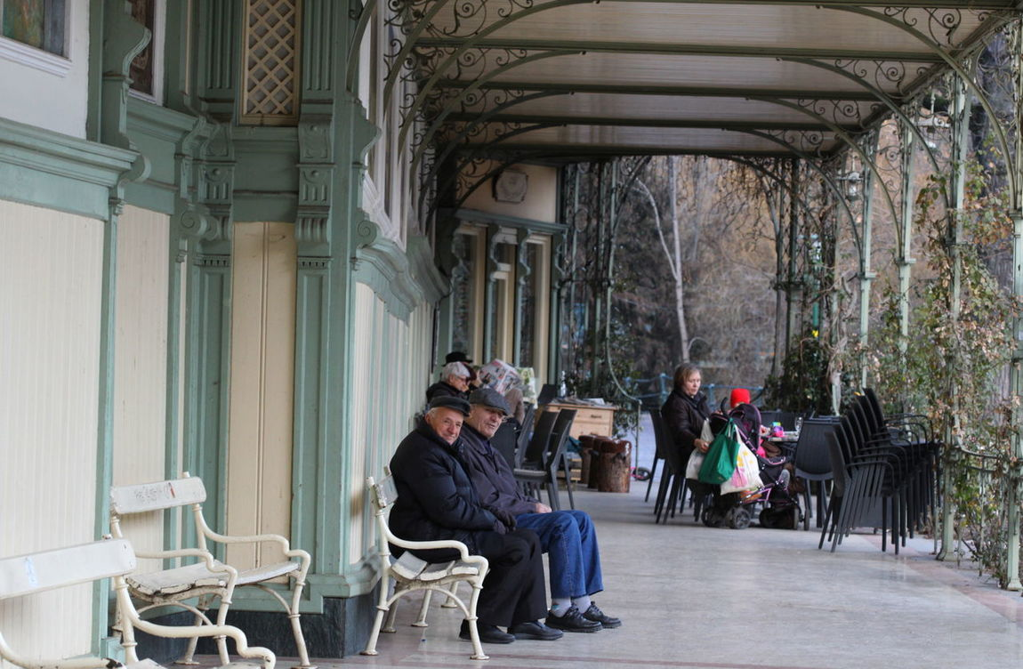 Gallery Looking At Camera Meran,Italy Metal Benches Old Men Town Center Tradition Winterpromenade