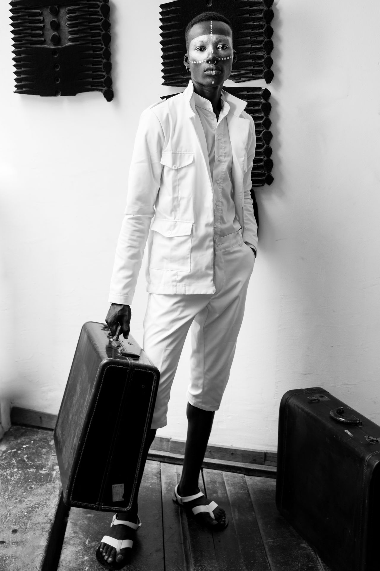 Africa African Beauty Blackandwhite Photography Casual Clothing Day Fashion Fashion Photography Front View Indoors  Lifestyles Looking At Camera Luggage One Person People Portrait Real People Standing Suitcase