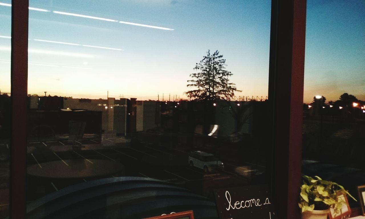 Sunset Window Transparent Indoors  Window Sunset Transparent Indoors  Glass - Material City Cityscape Sky Cloud Reflection Illuminated Glass No People Moody Sky Grassland Tree