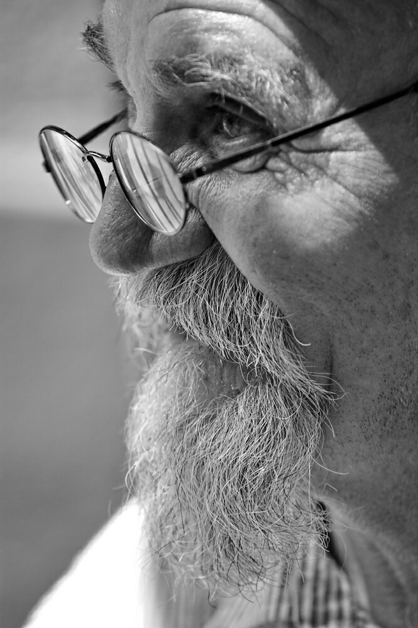 senior adult, one person, real people, human face, close-up, beard, eyeglasses, men, human body part, outdoors, human hand, day, adult, adults only, people