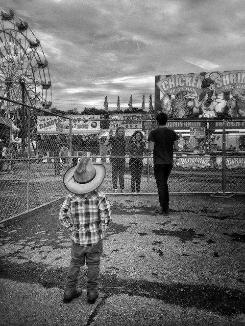 At the fair. B&W Portrait B&w Photography Cowboy Little Cowboy Kids Carnival B&w Street Photography Cowboy Hat The Street Photographer - 2016 EyeEm Awards State Fair Carnival Rides Ferris Wheel Young Boy Teenager