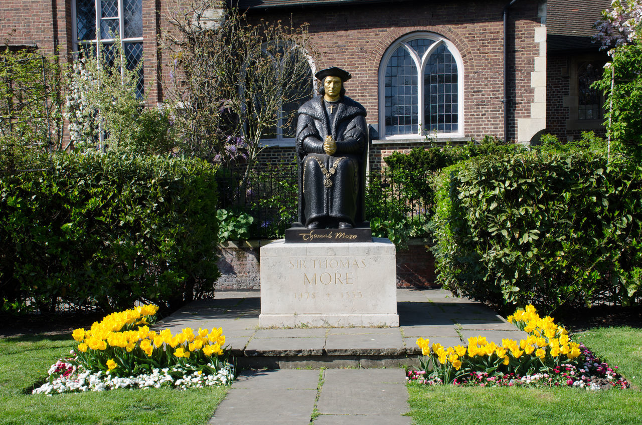 Statue of Sir Thomas Moore at Chelsea Old church in London Architecture Chelsea Church Flower Human Representation Memorial Religion Statue Thames Thomas More Yellow