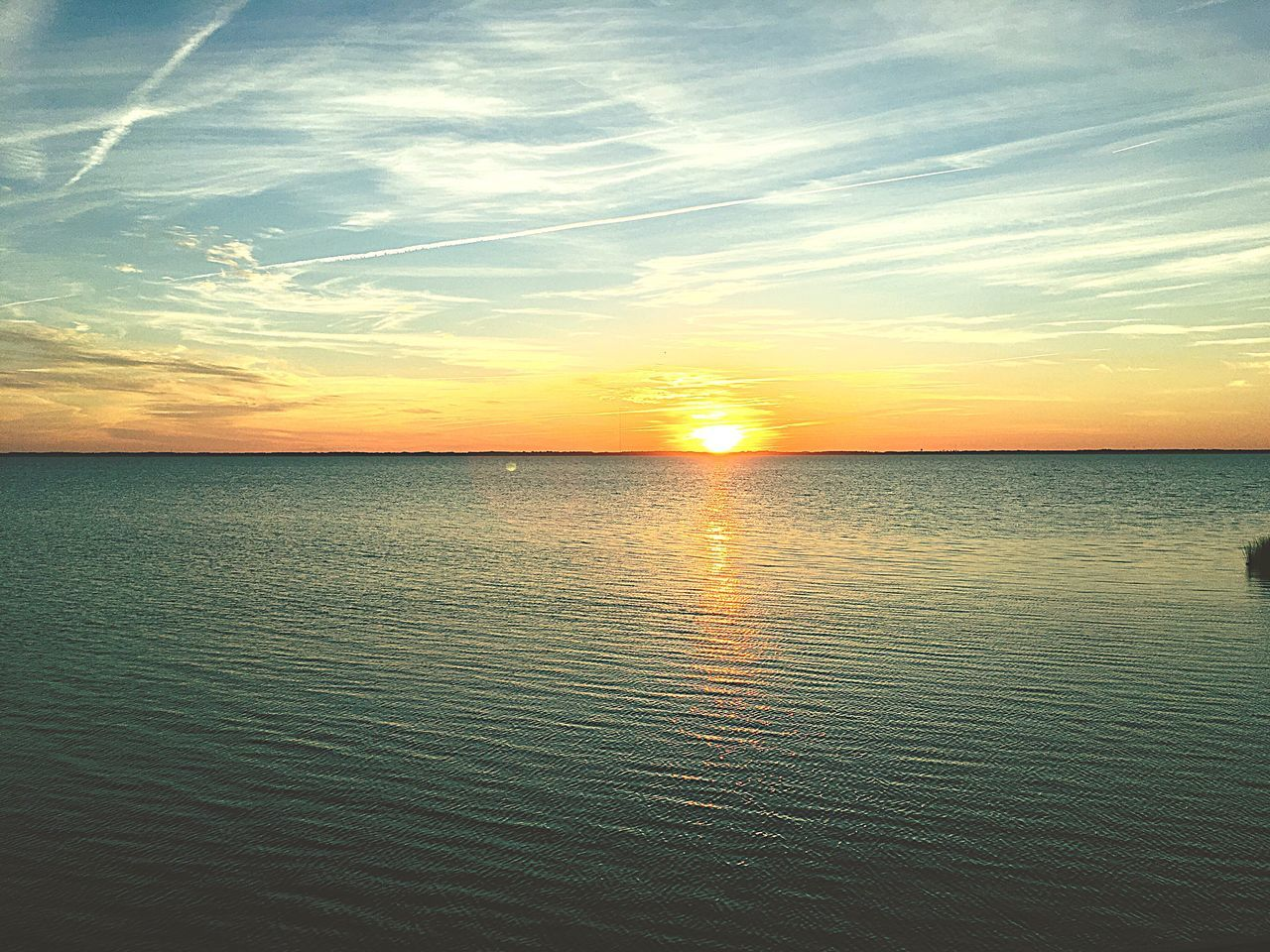 sunset, scenics, sea, tranquility, tranquil scene, beauty in nature, water, reflection, nature, idyllic, sky, sun, no people, horizon over water, outdoors, waterfront, beach, day