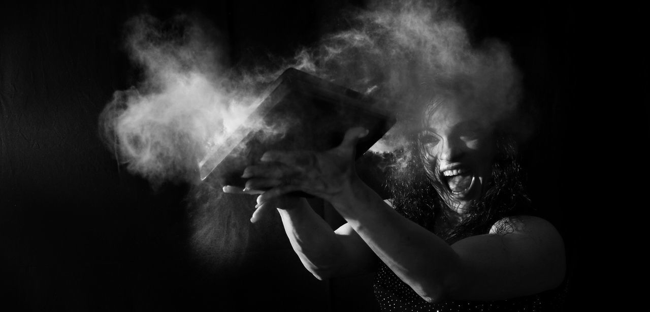 one person, smoke - physical structure, real people, black background, studio shot, motion, lifestyles, night, young adult, performance, human body part, young women, human hand, indoors, close-up, adult, people, talcum powder, adults only