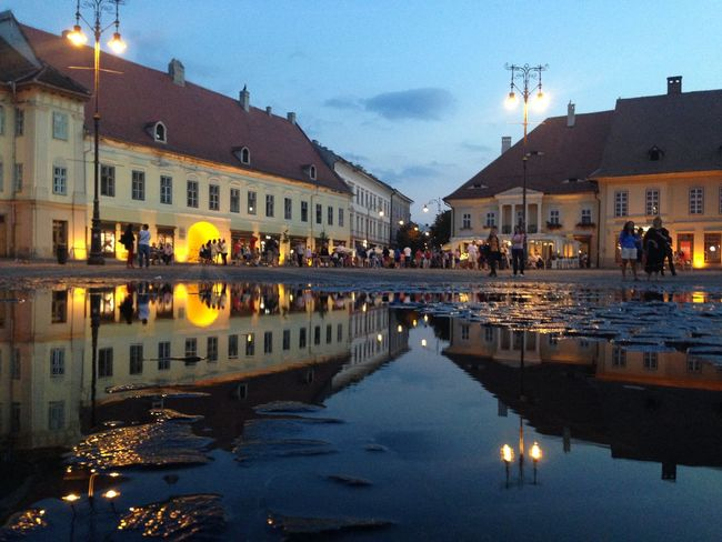 Sibiu looking good at night as if it could be mistaken for its own reflection Architecture Blue Building Exterior Built Structure City City Life Illuminated In Front Of Night Old Town Outdoors Reflection Residential Building Residential District Residential Structure Sky Standing Water Water Waterfront
