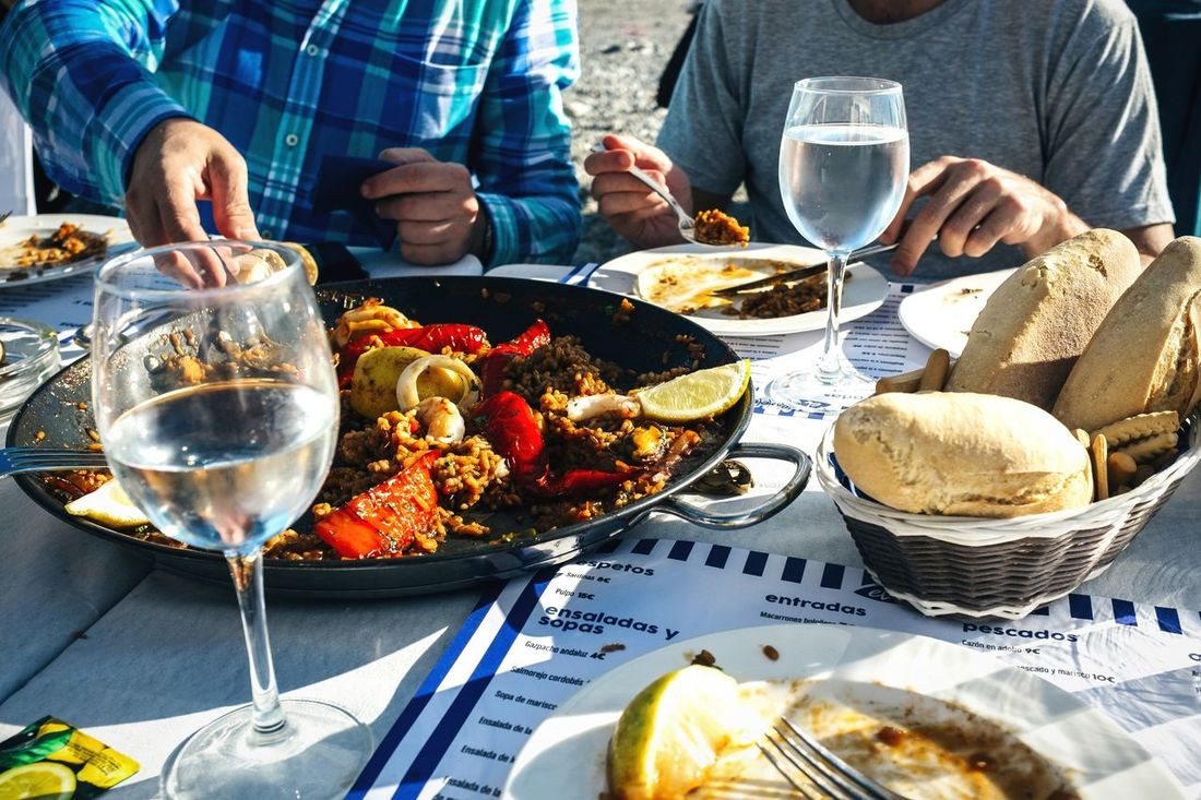Paella on the beach Food Wineglass Table Eating Restaurant Drinking Glass Food And Drink Wine Meal Sitting Gourmet Healthy Eating Paellas Spanish Food Eating Healthy Wine Moments SPAIN Delicious White Wine <3 Togetherness Eating Out Seafoods Spanish Lifestyles Dining Table