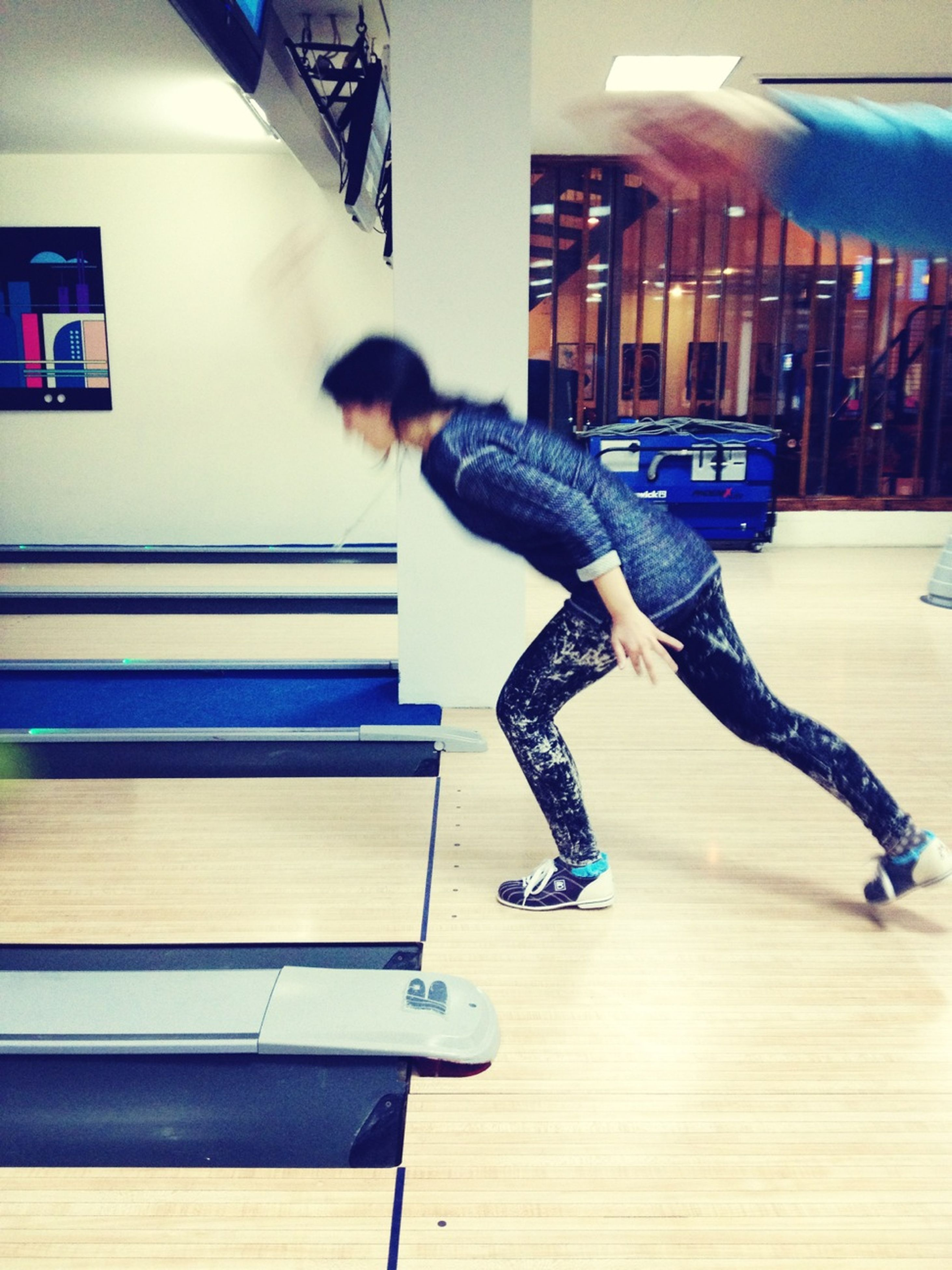 indoors, full length, lifestyles, leisure activity, playing, childhood, skill, casual clothing, side view, sitting, boys, music, hobbies, balance, arts culture and entertainment, fun, technology, blue