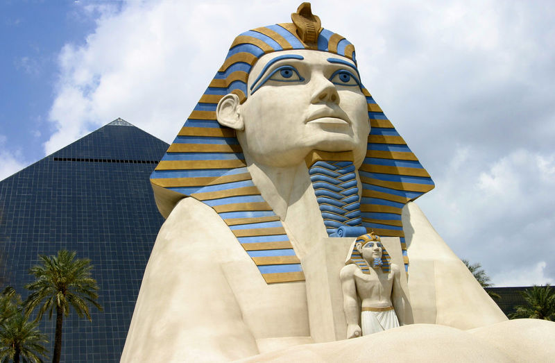 The Luxor Hotel - - Las Vegas, USA Architecture Sky Statue Day Outdoors Pyramid Sculpture Sphynx No People Low Angle View Cloud - Sky Building Exterior Built Structure Human Representation Pyramid Hotel A Taste Of Vegas Hotels In Las Vegas - Las Vegas, USA Colour Your Horizn