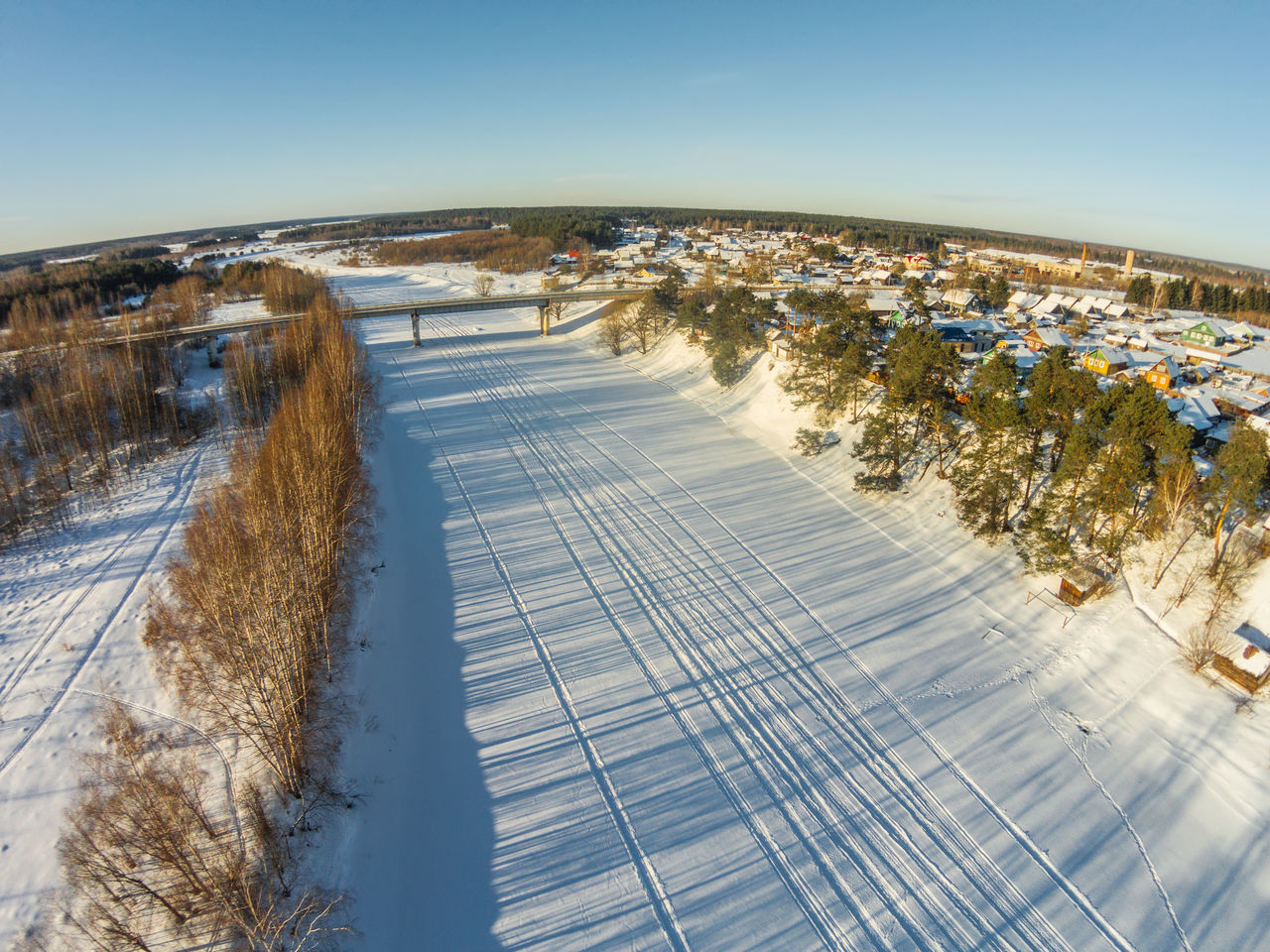 Aerial view of the river Mologa near the village Fabrika. A Bird's Eye View Aerial Aerial View Beauty In Nature Clear Sky Cold Temperature Day Drone  Dronephotography Ice Nature Outdoors River Shadow Sky Snow Top Perspective Tree Winter
