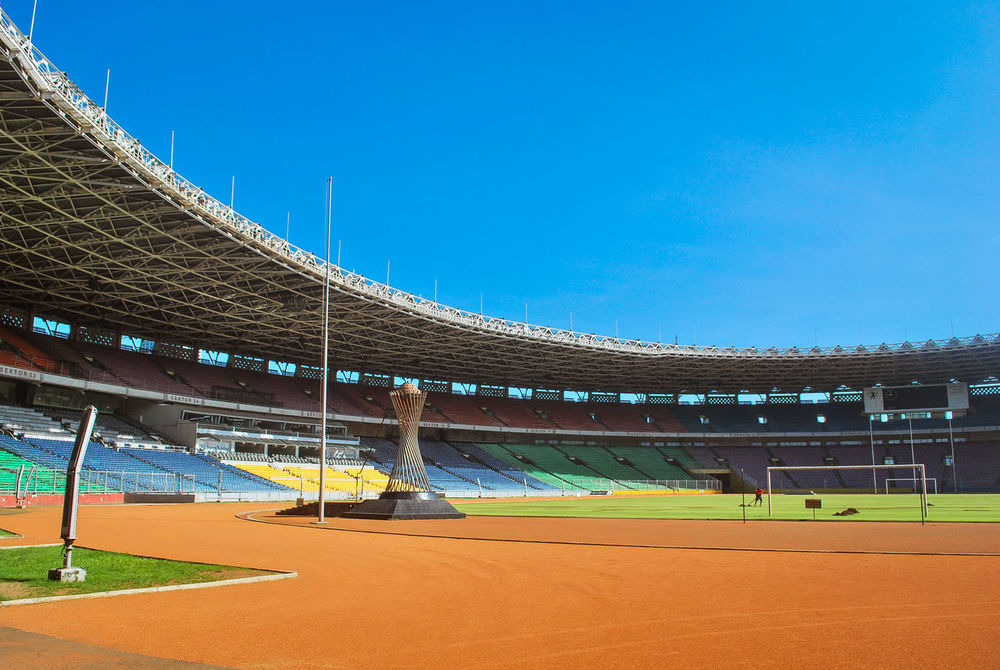 Gelora Bung Karno Stadium Stadium Blue Blue Sky Building Building And Sky Built Structure Stadion Landscapes Jakarta INDONESIA Architecture Architecture_collection Football Stadium Clear Sky Balance Gelorabungkarno EyeEm Best Shots Eye4photography  My Favorite Photo The Architect - 2016 EyeEm Awards Found On The Roll
