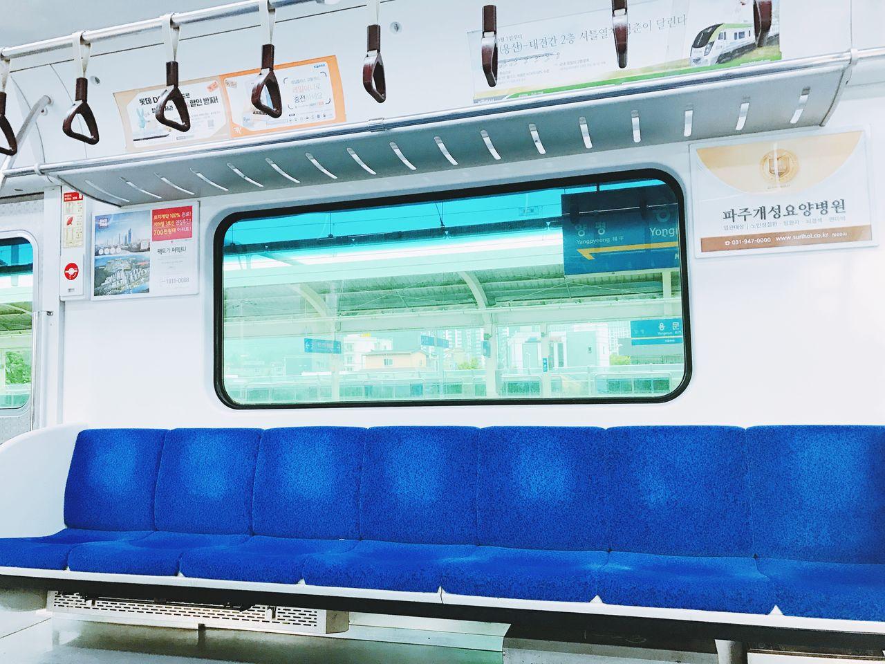public transportation, train - vehicle, mode of transport, transportation, window, no people, communication, text, vehicle seat, blue, day, indoors