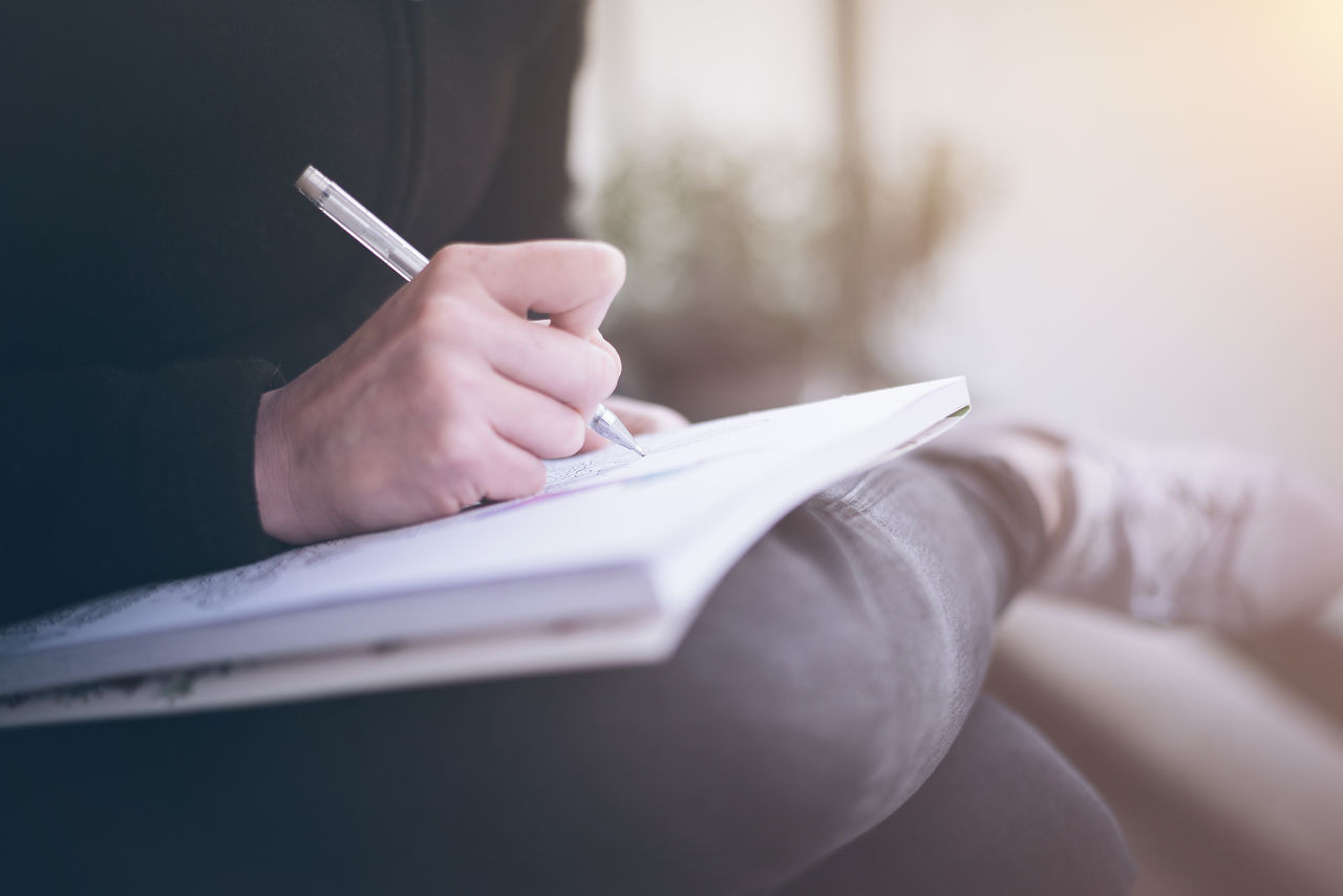 Adult Book Close-up Day Diary Education Holding Human Body Part Human Hand Indoors  Learning Midsection Note Pad One Person Paper Pen People Sitting Student Women Working Writing Young Adult Young Women