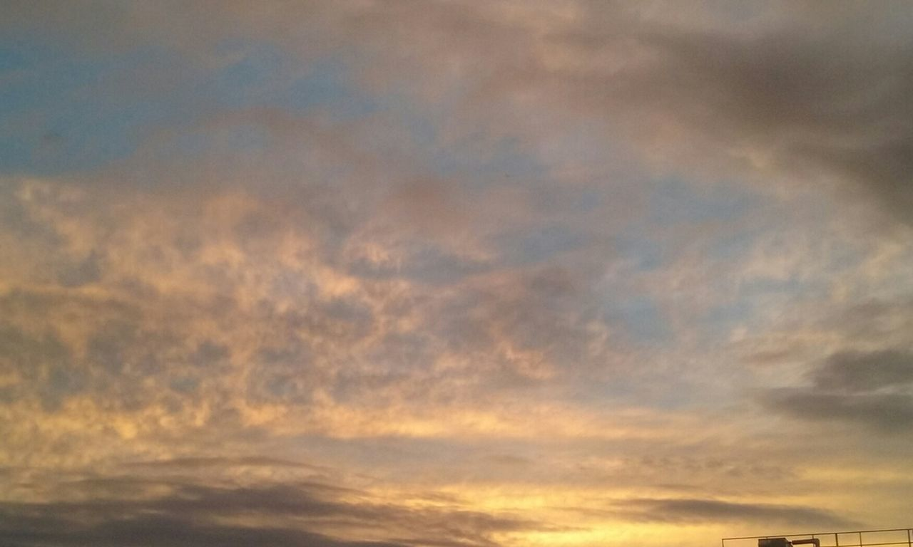 sunset, cloud - sky, sky, nature, beauty in nature, dramatic sky, scenics, low angle view, backgrounds, cloudscape, tranquility, tranquil scene, no people, sky only, abstract, outdoors, full frame, multi colored, day
