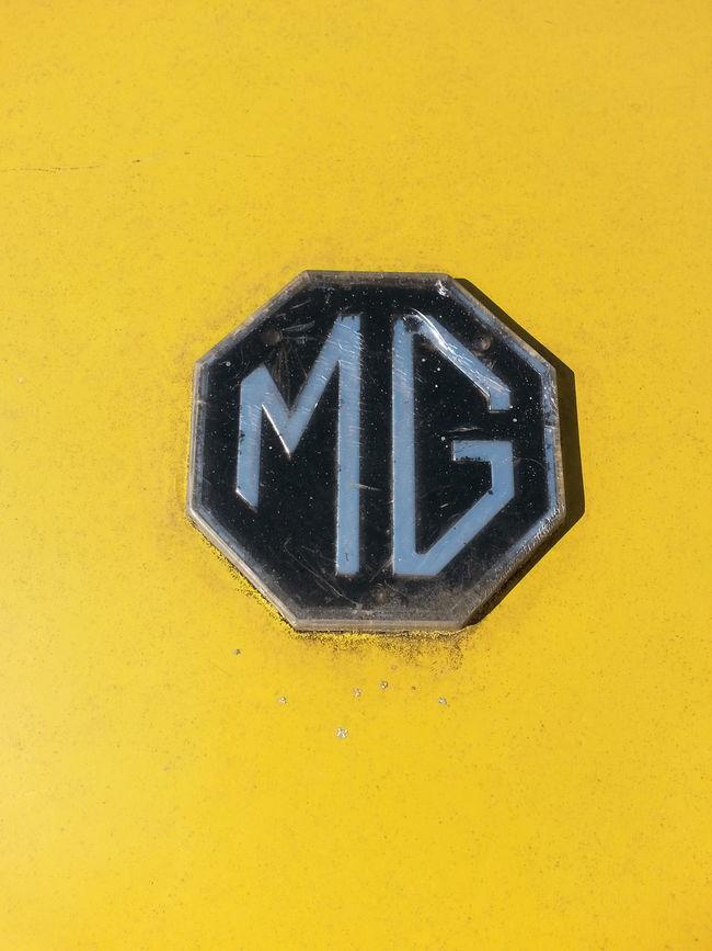 MG  Emblem  Trunk Detail Yellow Transportation 1974 Midget Close-up