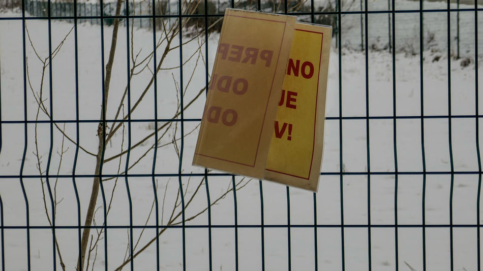 Close-up Cold Day Low Angle View No People Outdoors Red Letters Sky Snow Warning Warning Sign Warning Sign In Nature Yellow Sigh With Red Letters Yellow Sign