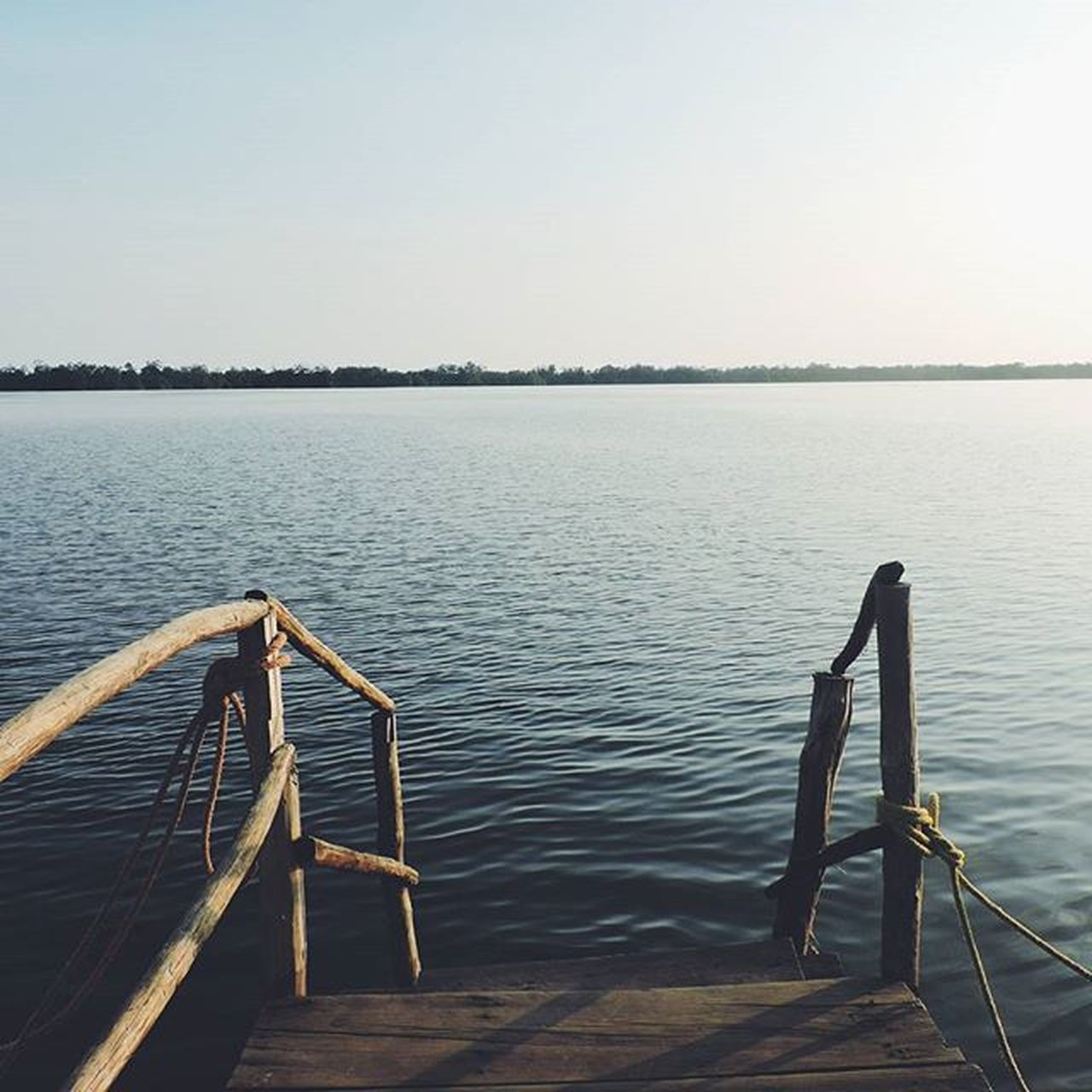 railing, water, tranquility, lake, outdoors, clear sky, nature, sky, day, no people, beauty in nature