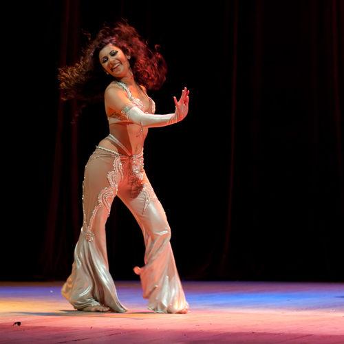 Art Black Background Creativity Dancing Hair Flowing Indoors  Motion Posing Smiling Woman