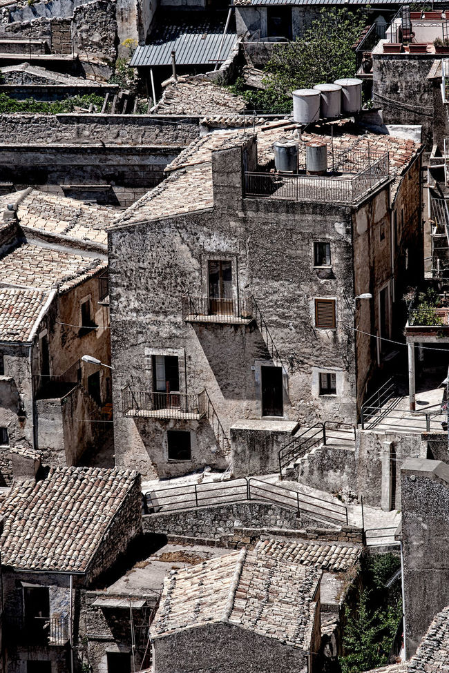 View over the rooftops 2 Architecture Architecture Brown Color Building Exterior Built Structure Day Exterior Full Frame History House Houses In A Row No People Outdoors Repetition Roof Pans Rooftops Stone Material Stone Wall Town Weathered Window