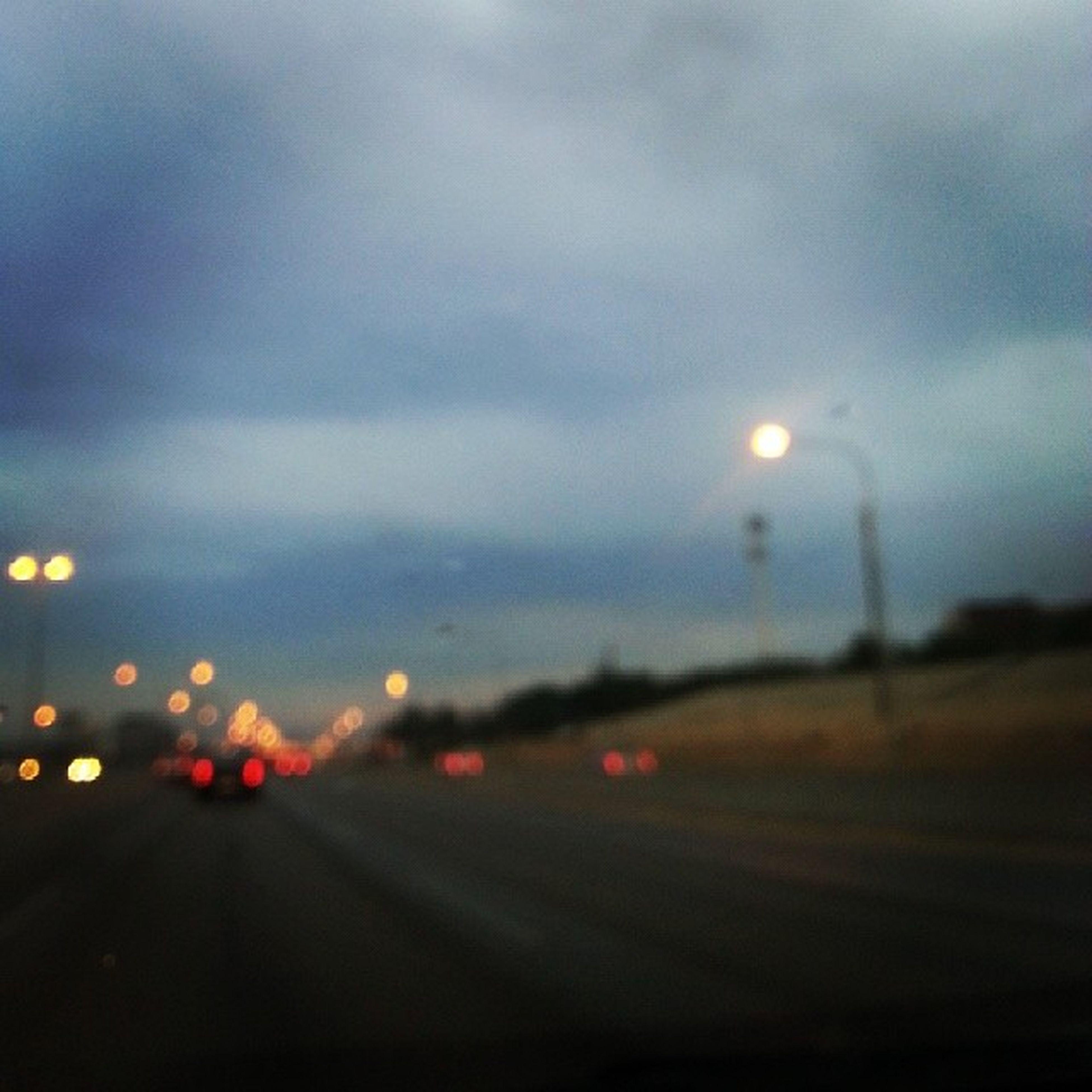 transportation, illuminated, road, sky, defocused, transparent, night, car, street, weather, street light, wet, glass - material, dusk, the way forward, land vehicle, mode of transport, rain, cloud - sky, road marking