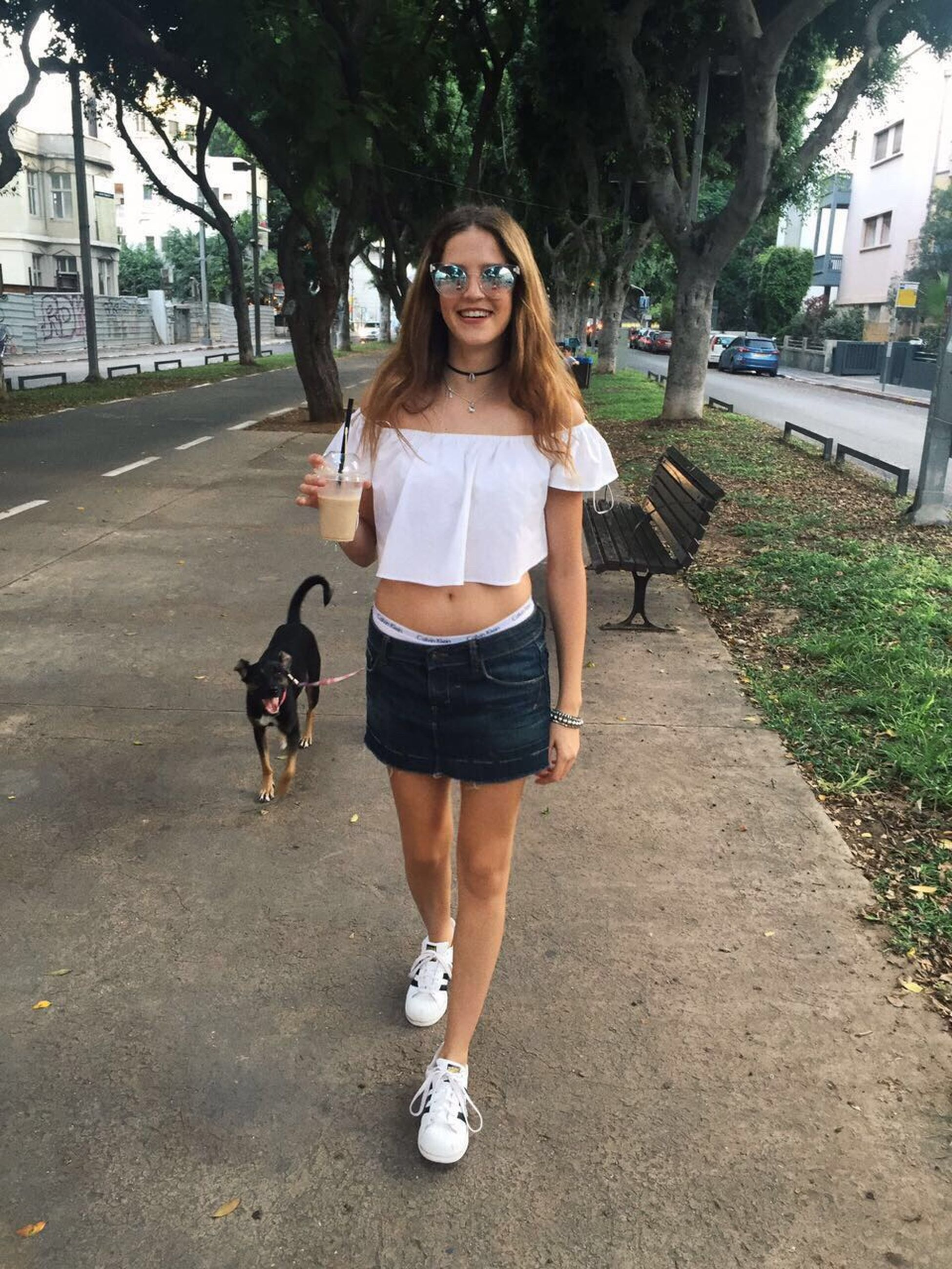 full length, young women, casual clothing, young adult, lifestyles, long hair, person, leisure activity, standing, road, front view, street, transportation, blond hair, shoulder bag, beauty, brown hair, shoe, footpath, day, outdoors