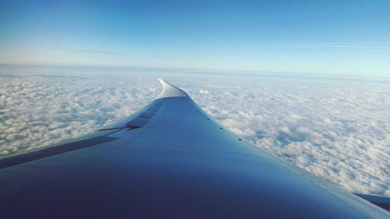 airplane, flying, aerial view, transportation, airplane wing, scenics, sky, journey, air vehicle, aircraft wing, beauty in nature, travel, nature, blue, no people, tranquil scene, mode of transport, mid-air, cloud - sky, day, landscape, tranquility, sea, vehicle part, outdoors, the natural world