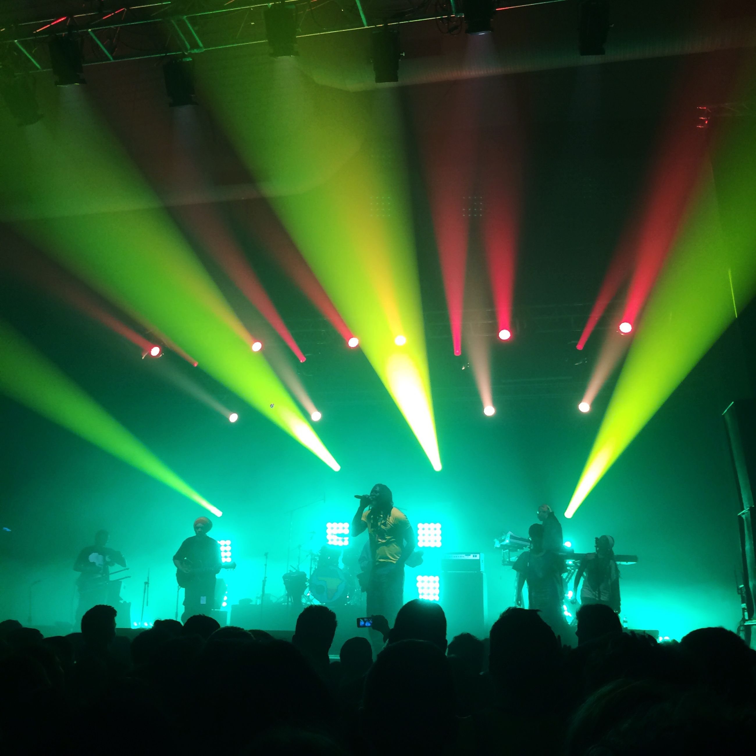 illuminated, indoors, night, nightlife, large group of people, person, stage - performance space, lighting equipment, arts culture and entertainment, performance, music, crowd, men, lifestyles, event, stage light, enjoyment, light - natural phenomenon, leisure activity