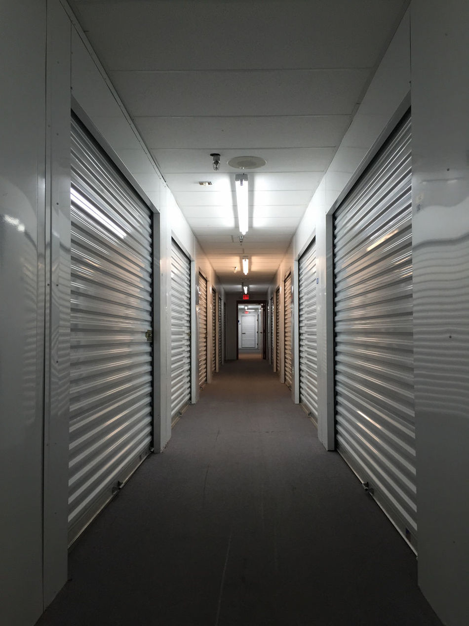 Architecture Building Built Structure Ceiling Corridor Diminishing Perspective Door Empty Illuminated In A Row Indoors  Lighting Equipment Lockers Narrow Shutters Storage Storage Room Storage Unit The Way Forward Vanishing Point Wall Wall - Building Feature