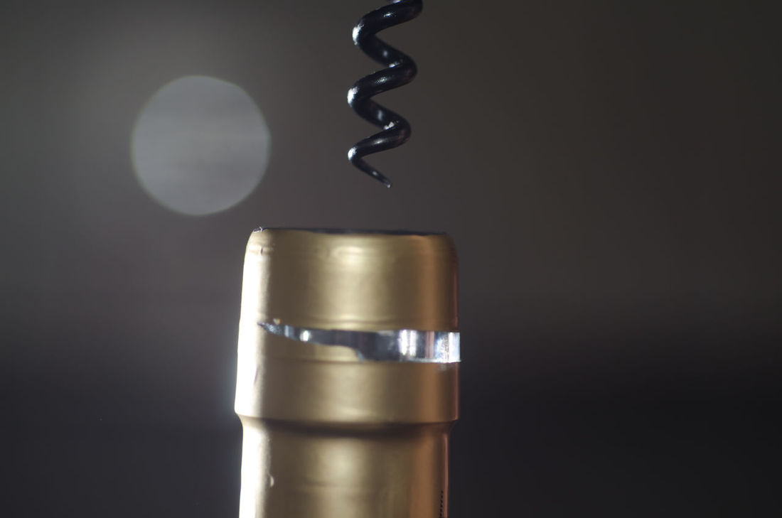 Corkscrew and Wine Bottle Alchol Close Up Close-up Color Cork - Stopper Corkscrew Day Full Frame Gold Colored Indoors  Lens Flare Metal No People Open Part Of Simplicity Spiral Studio Shot Wine Wine Bottle Wine Culture Wine Moments Work Tool