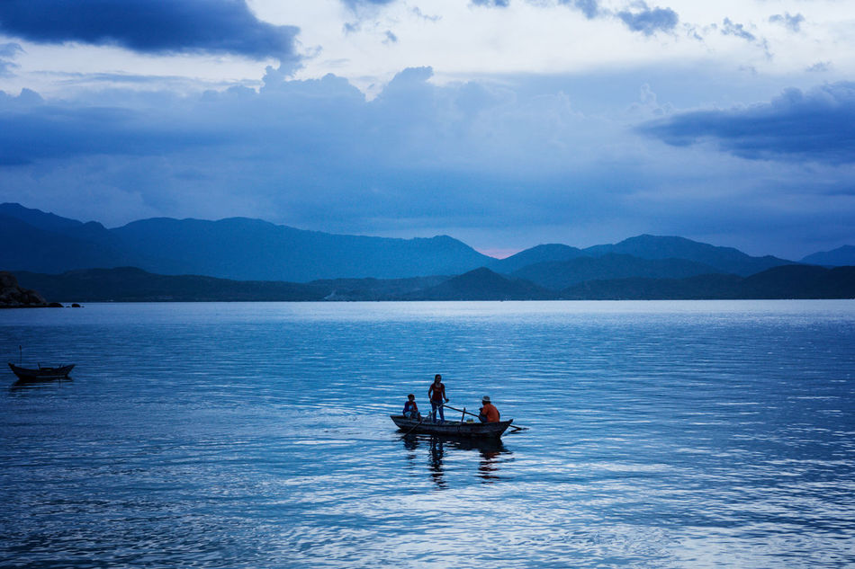 Harmony family rowing boat Beauty In Nature Blue Sky Cloud - Sky Family Fisherman Fishing Boat Lifestyles Mountain Mountain Range Nature Ocean Oceanside Outdoors Relaxing Sitting Sky Travel Travel Photography Traveling Vacations Vacations Vietnam Water Wave Waves, Ocean, Nature