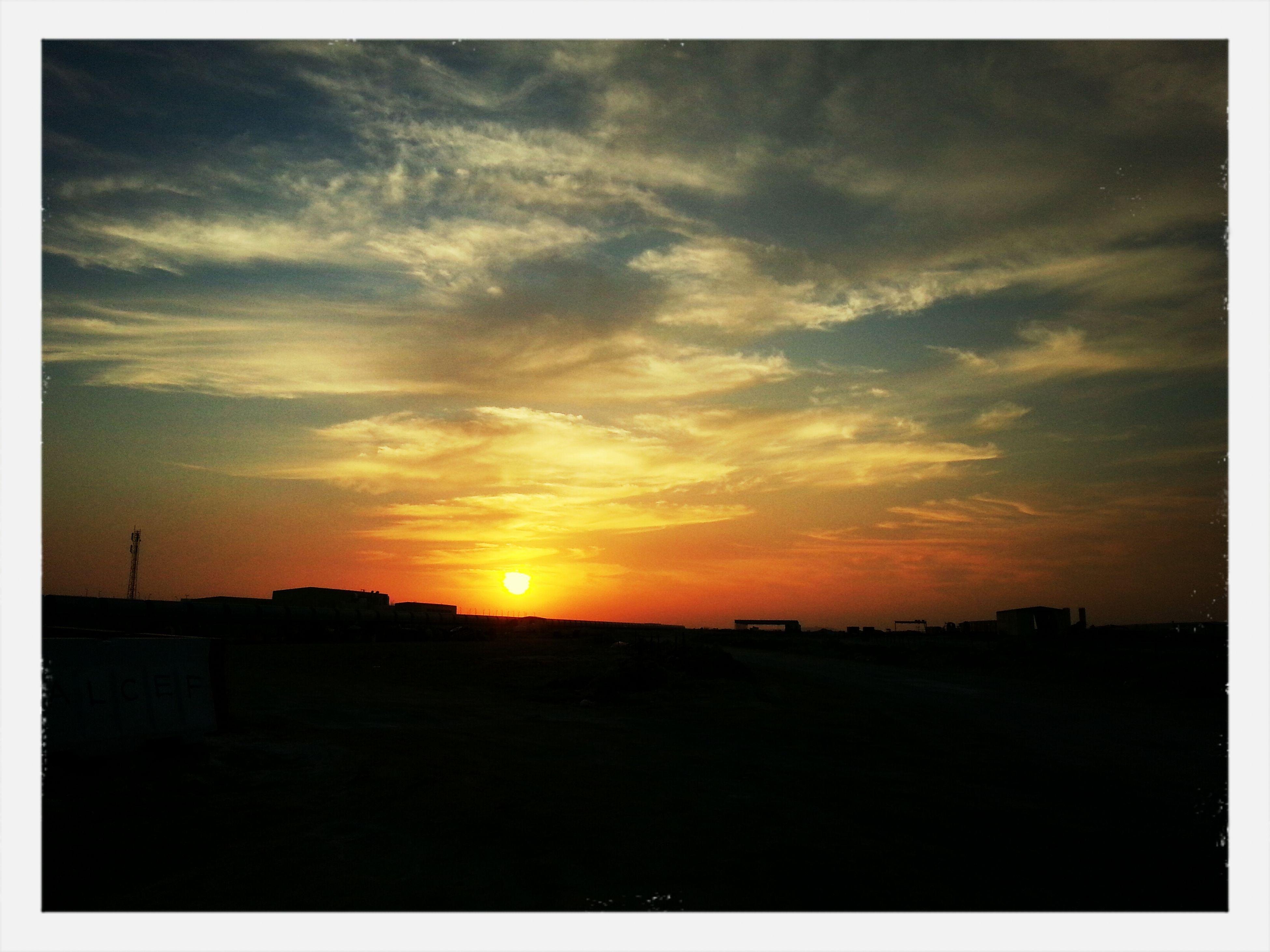 sunset, silhouette, sun, sky, orange color, scenics, beauty in nature, tranquil scene, transfer print, tranquility, cloud - sky, landscape, nature, idyllic, sunlight, auto post production filter, dark, dramatic sky, cloud, built structure