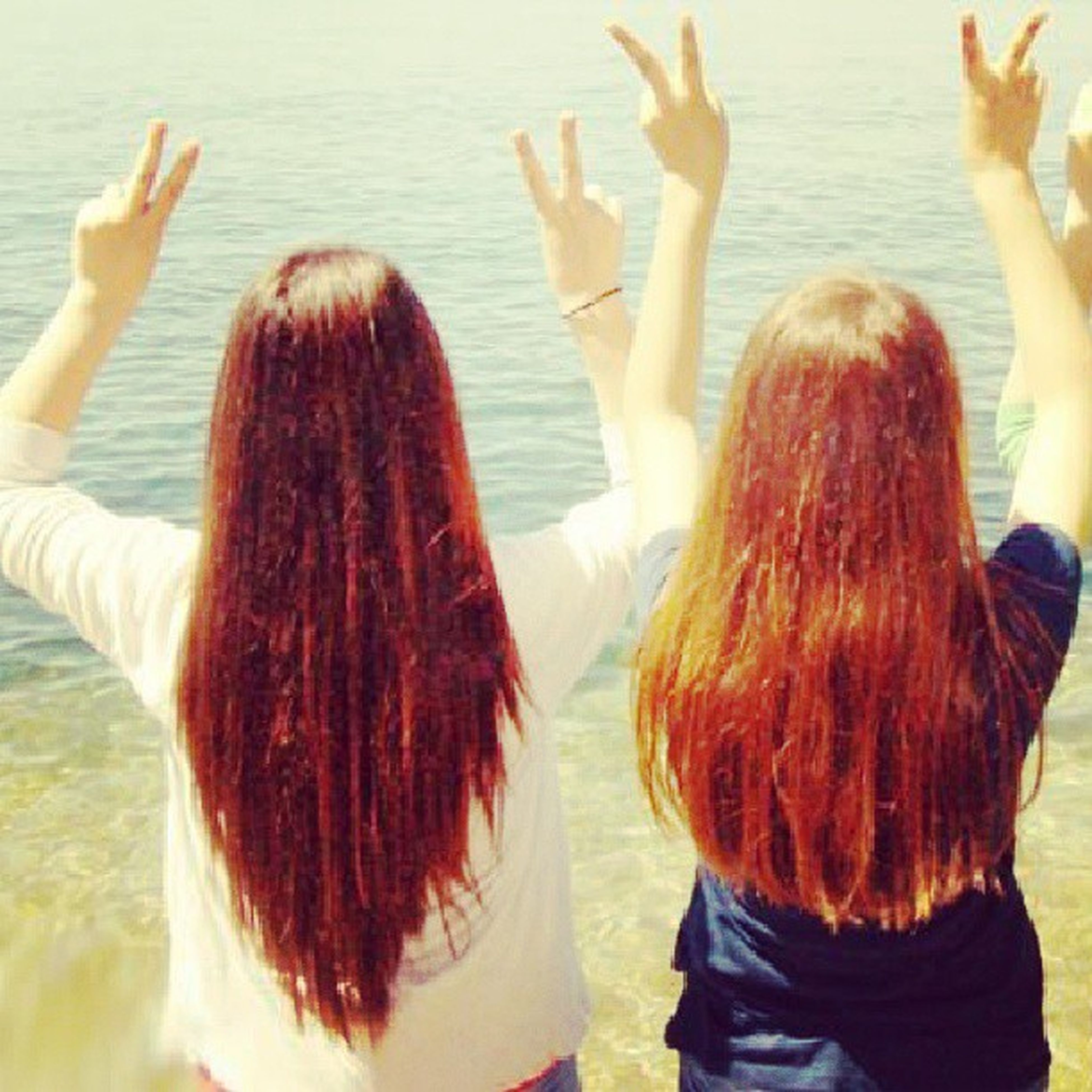 lifestyles, leisure activity, long hair, young women, togetherness, water, person, bonding, vacations, young adult, rear view, enjoyment, blond hair, brown hair, love, friendship