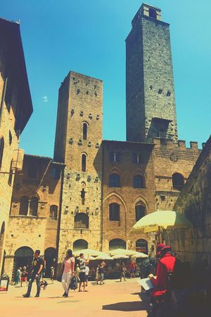 Beautiful day at San Gimigniano ☺️ Architecture Built Structure Building Exterior Real People Men Clear Sky Day Travel Destinations Lifestyles Sky Women Blue Outdoors Low Angle View The Street Photographer - 2017 EyeEm Awards EyeEm Gallery EyeEm Vacations Live For The Story BYOPaper! History Brick Wall City People Adult Live For The Story BYOPaper! The Street Photographer - 2017 EyeEm Awards The Great Outdoors - 2017 EyeEm Awards The Architect - 2017 EyeEm Awards The Photojournalist - 2017 EyeEm Awards EyeEmNewHere Neon Life