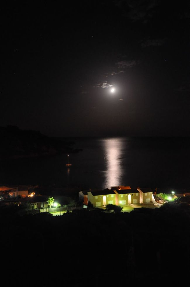 Night Sky Beauty In Nature Moon Water Outdoors Illuminated Building Exterior Nature No People Tranquility Architecture Scenics Built Structure Tranquil Scene Sea City Star - Space Astronomy in Corse