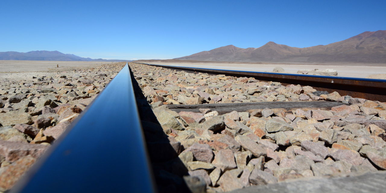Chiguana salt flat. Railway Antofagasta (Chile)/Bolivia Andes Andes Mountains Antofagasta Arid Climate Blue Bolivia Chiguana Chiguana Salt Flat Clear Sky Desert Eyeem Bolivia Landscape Mountain No People Outdoors Rail Railroad Track Railway Salar De Chiguana Salt Flat Scenics Transportation Travel Uyuni Finding New Frontiers