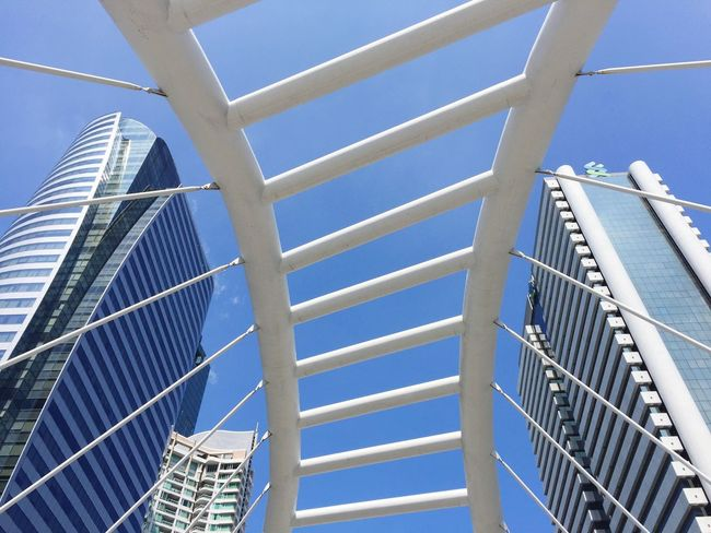 Close Up Street Photography Close Up Close-up Street Streetart Street Art Macro Architecture Low Angle View Built Structure Building Exterior Modern Day No People Outdoors Skyscraper City Sky Sunny Day Clouds And Sky Spotted In Thailand Style Thailand Pattern 2016