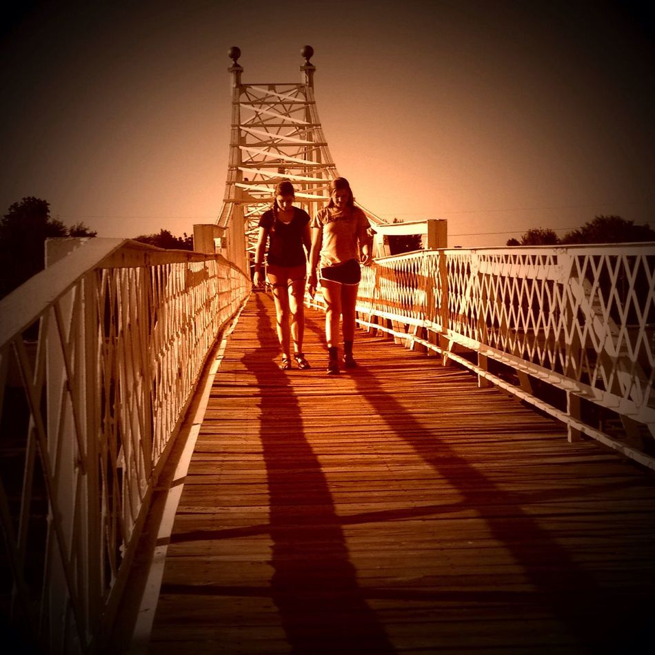 Railing Walking Full Length Commercial Street Footbridge Togetherness Shadow Bridge - Man Made Structure Narrow Wood Paneling Day Pier Person Outdoors The Way Forward Walkway Jetty Pathway
