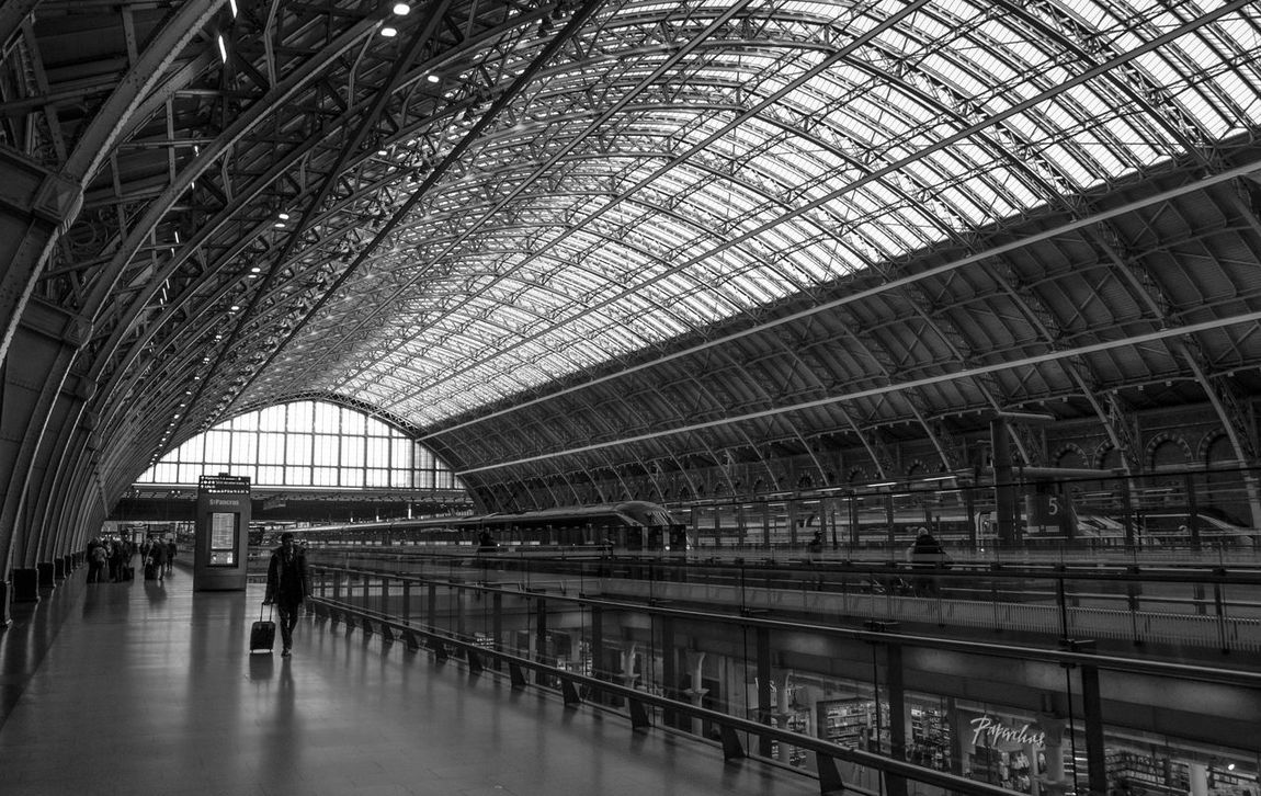 St PancrasArchitecture Built Structure Commuter Indoors  Luggage One Person Public Transportation Railroad Station Real People Transportation Transportation Building - Type Of Building Kings Cross Railway Station St Pancras Architecture BnWBlackandwhite Photography The Architect - 2017 EyeEm Awards Postcode Postcards