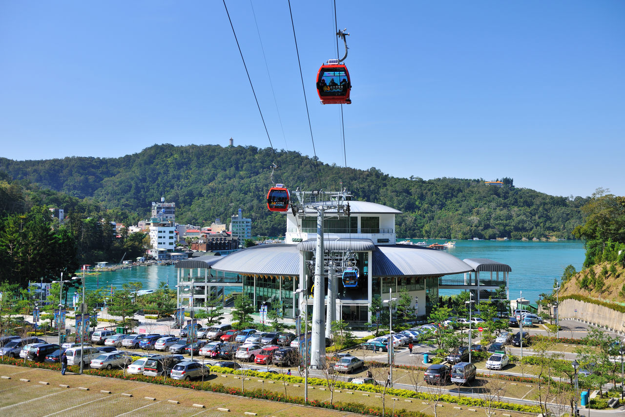 Blue Building Cable Car Construction Day Flag Go Sightseeing Lake Landscape Mountain Mountain View Nature Nautical Vessel Outdoors Overhead Cable Car Parking Lot People Sky Taiwan Traffic Transport Travel View Water