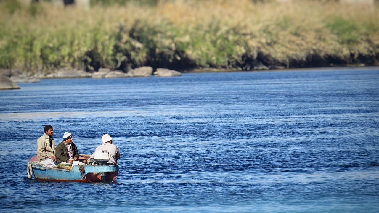 Beauty In Nature Botany Day Fishing Nature Old Boat Real People Sea Water