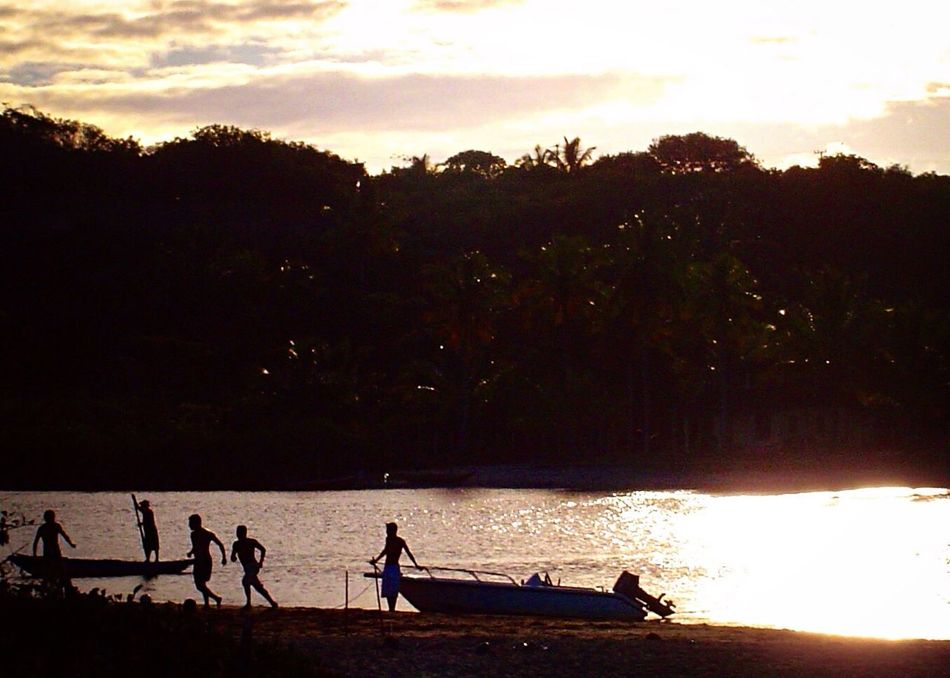 Sunset Water Real People Sky Nature Silhouette Beauty In Nature Scenics Tree Men Outdoors Sea Tranquil Scene Full Length Day Soccer Fisherman's Boat Sunset Silhouettes Sunset At The River Recreation  Travel Caraíva -Brazil EyeEmNewHere