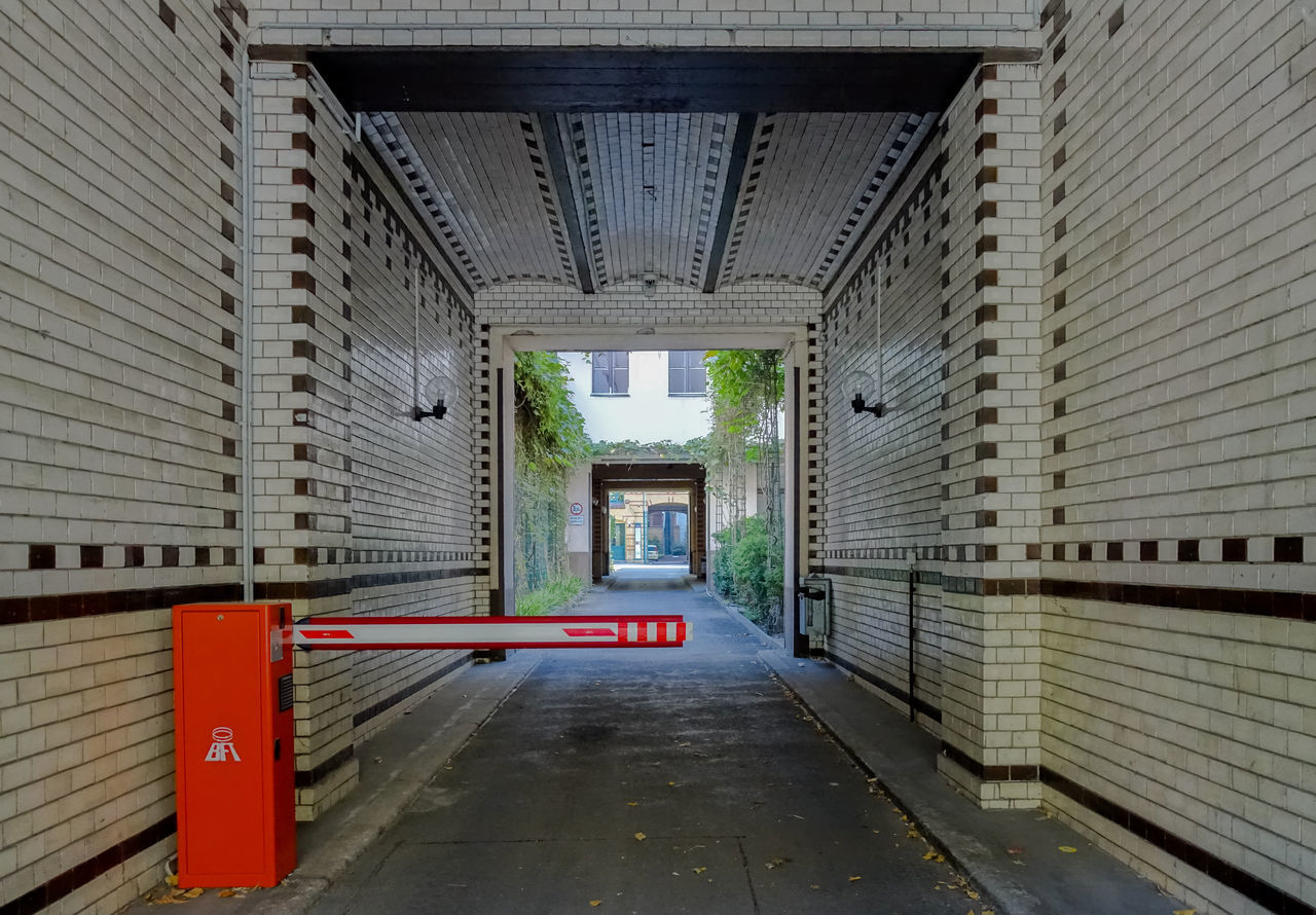 Architecture Backyard Barrier Building Exterior Built Structure City City Life Day Entrance Entrance Gate Hauseinfahrt Hinterhof Kreuzberg Long Narrow No People Outdoors Pedestrian Walkway Red Schranke The Way Forward Walkway