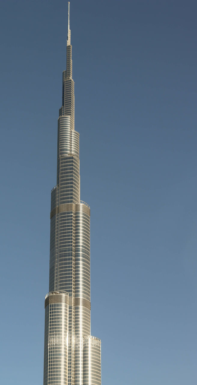 tall - high, skyscraper, architecture, built structure, building exterior, tower, clear sky, low angle view, modern, no people, day, outdoors, city, sky