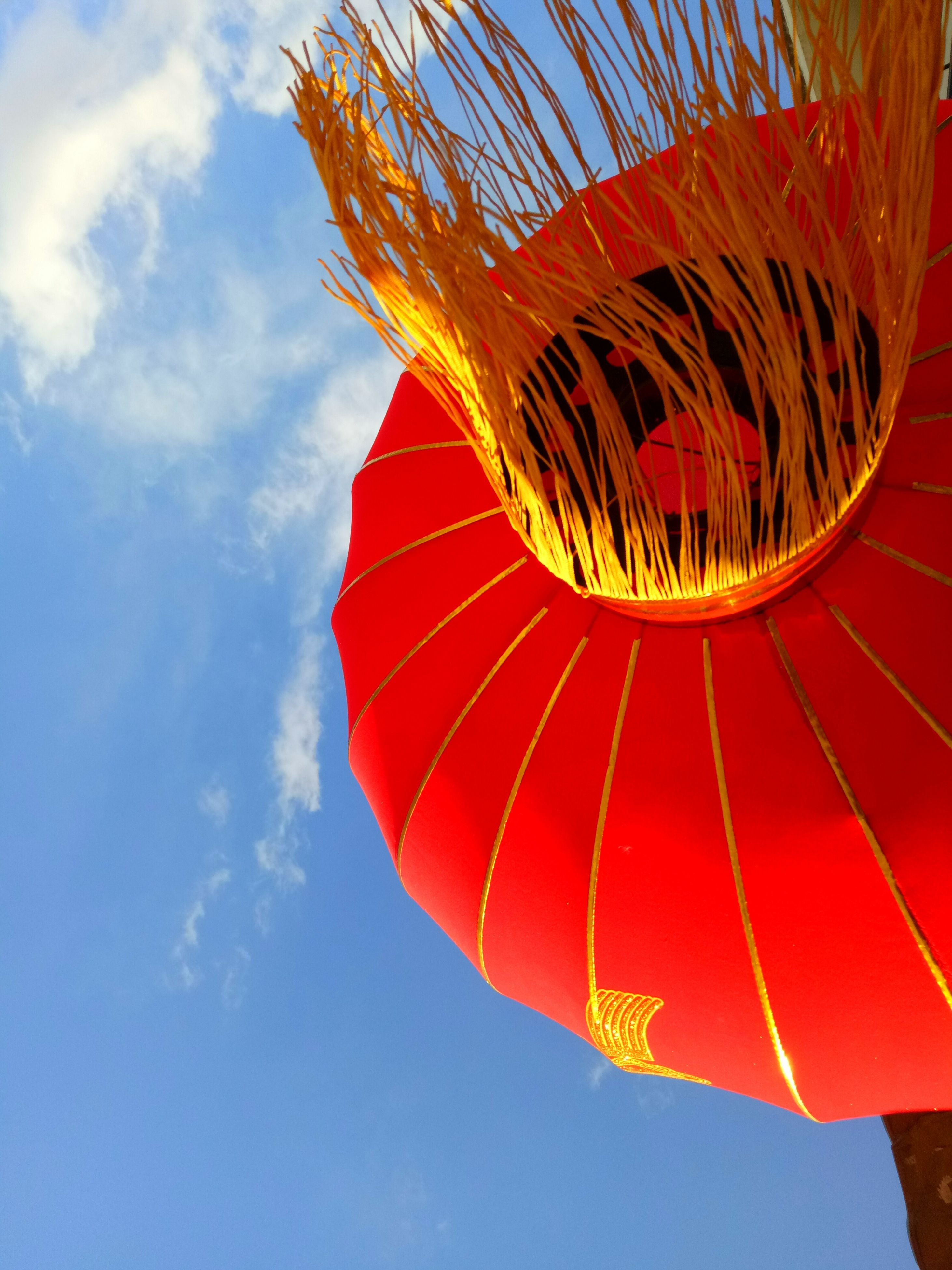 sky, multi colored, low angle view, cloud - sky, celebration, outdoors, red, traditional festival, chinese lantern festival, chinese lantern, day, no people